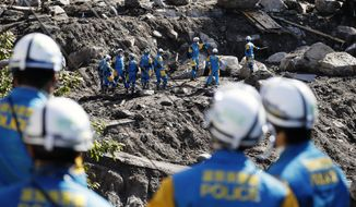 Rescuers search for missing persons at the site of a landslide triggered by Typhoon Hagibis, in Marumori town, Miyagi prefecture, Japan Wednesday, Oct. 16, 2019. The typhoon hit Japan's main island on Saturday with strong winds and historic rainfall that caused more than 200 rivers to overflow, leaving thousands of homes flooded, damaged or without power. (Kota Endo/Kyodo News via AP)