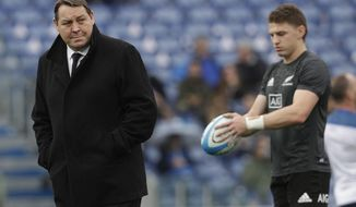 FILE - In this Nov. 24, 2018, file photo, New Zealand All Blacks coach Steve Hansen, left, walks on the pitch before the start of the rugby union international match between Italy and New Zealand at the Olympic Stadium in Rome. Of the eight teams remaining in the Rugby World Cup four are coached by New Zealanders who, from similar beginnings, pursued divergent coaching careers before their paths intersected at this tournament. (AP Photo/Gregorio Borgia, File)