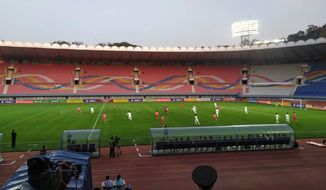 In this photo provided by the Korea Football Association, South and North Korean, wearing red uniforms, players play during their Asian zone Group H qualifying soccer match for the 2022 World Cup at Kim Il Sung Stadium in Pyongyang, North Korea, Tuesday, Oct. 15, 2019. South Korea soccer officials say they can't see a telecast of the historic World Cup qualifier in Pyongyang between their national team and North Korea, and think the game was proceeding at an empty Kim Il Sung Stadium. (The Korea Football Association via AP)
