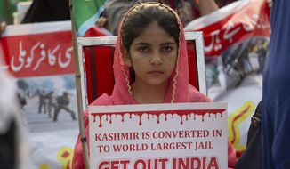 Supportersw of Pakistani religious party Jamaat-e-Islami rally to express solidarity with Indian Kashmiris, in Islamabad, Pakistan, Wednesday, Oct. 16, 2019. Pakistani and Indian troops traded fire in the disputed Himalayan region of Kashmir on Wednesday, killing four civilians and wounding nearly a dozen others, officials from both sides said, as tensions remain high between the two South Asian countries. (AP Photo/B.K. Bangash)