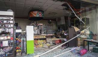 Debris are scattered on the floor of a damaged store a day after a strong quake struck in Digos, Davao del Sur province, southern Philippines Thursday, Oct. 17, 2019. A powerful and shallow earthquake hit several southern Philippine provinces Wednesday night injuring some people in collapsed houses and prompting thousands to scramble out of homes, shopping malls and a hospital in panic, officials and news reports said. (AP Photo)