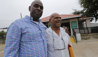 Elvis Brooks walks out of the Louisiana State Penitentiary at Angola with his brother Aaron Brooks, left, in Angola, La., Wednesday, Oct. 16, 2019. Elvis Brooks, who has spent two-thirds of his life in prison for a killing he always denied committing, pleaded guilty to manslaughter and was released. Since his arrest in 1977, Brooks has maintained that he's innocent. Innocence Project New Orleans attorneys say evidence that would have cleared him was withheld at trial. Prosecutors offered the plea agreement Tuesday which was accepted. (AP Photo/Gerald Herbert)