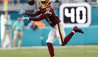 Washington Redskins wide receiver Terry McLaurin (17) grabs a pass, during the second half at an NFL football game against the Miami Dolphins, Sunday, Oct. 13, 2019, in Miami Gardens, Fla. McLaurin scored two touchdowns. The Redkskins defeated the Dolphins 17-16. (AP Photo/Brynn Anderson) ** FILE **