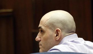 """FILE - In this Aug. 15, 2019 file photo Michael Gargiulo listens as his guilty verdicts on all counts are read in Los Angeles Superior Court. A Los Angeles jury will decide whether a man prosecutors have dubbed """"The Boy Next Door Killer"""" will get a sentence of death or life in prison for the killings of two women and the attempted murder of a third. Closing arguments ended Wednesday, Oct. 16, 2019, in the penalty phase of the trial of 43-year-old Gargiulo, and jurors will now deliberate his fate. (Al Seib/Los Angeles Times via AP, Pool, File)"""