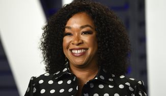 FILE - This Feb. 24, 2019 file photo shows Shonda Rhimes at the Vanity Fair Oscar Party in Beverly Hills, Calif. Rhimes is moving aggressively into the burgeoning podcast world. Rhimes' company, Shondaland, said Wednesday that she will serve as executive producer for podcasts to be distributed by iHeartMedia. Rhimes' company said it signed a three-year podcast deal with iHeartMedia and is launching Shondaland Audio. (Photo by Evan Agostini/Invision/AP, File)