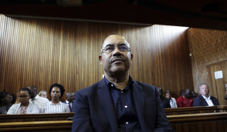 FILE -- In this Tuesday Jan. 8, 2019 file photo former Mozambican finance minister, Manuel Chang, appears in court in Kempton Park, Johannesburg, South Africa. Chang is challenging attempts to extradite him to the United States, as the extradition hearing got underway Wednesday Oct. 16, 2019, for an alleged corruption trial. (AP Photo/Phill Magakoe, File)