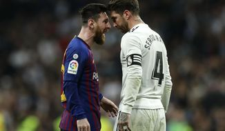 FILE - In this March 2, 2019 file photo, Barcelona forward Lionel Messi, left, goes head to head with Real defender Sergio Ramos as they argue during the Spanish La Liga soccer match between Real Madrid and FC Barcelona at the Bernabeu stadium in Madrid. The Spanish football league on Wednesday Oct. 16. 2019, has asked the Spanish football federation to change the location of the match between Barcelona and Real Madrid to avoid it coinciding with plans for a separatist rally. The league wants the federation to shift the match to Madrid. (AP Photo/Manu Fernandez, File)