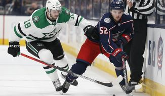 Dallas Stars' Jason Dickinson, left, and Columbus Blue Jackets' Emil Bemstrom, of Sweden, chase the puck during the second period of an NHL hockey game Wednesday, Oct. 16, 2019, in Columbus, Ohio. (AP Photo/Jay LaPrete)
