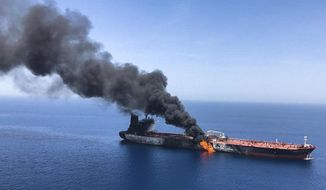 FILE - In this Thursday, June 13, 2019 file photo, an oil tanker is on fire in the sea of Oman. For decades considered a U.S. national security priority, the Persian Gulf remains home to tens of thousands of American troops spread across sprawling bases protecting crucial routes for global energy supplies. But while U.S.-Iran tensions in the Gulf appeared close to sparking a global conflagration this summer, attention now rapidly has shifted to Syria. (AP Photo/ISNA, File)
