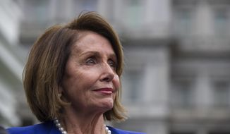House Speaker Nancy Pelosi of Calif., listens while speaking with reporters after a meeting with President Donald Trump at the White House, Wednesday, Oct. 16, 2019, in Washington. (AP Photo/Alex Brandon)