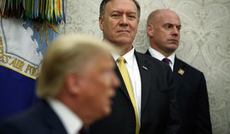 Secretary of State Mike Pompeo watches as President Donald Trump meets with Italian President Sergio Mattarella in the Oval Office of the White House, Wednesday, Oct. 16, 2019, in Washington. (AP Photo/Evan Vucci)