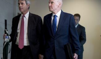 Michael McKinley, a former top aide to Secretary of State Mike Pompeo, right, arrives on Capitol Hill in Washington, Wednesday, Oct. 16, 2019, to testify before congressional lawmakers as part of the House impeachment inquiry into President Donald Trump. (AP Photo/Andrew Harnik)