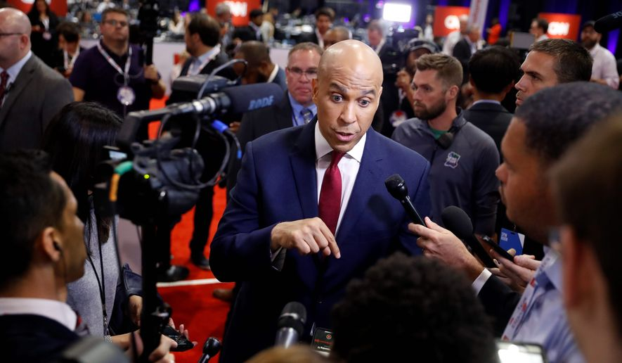"""""""Often when we talk about gun violence, the discussion focuses on deadly mass shootings, but in my neighborhood in Newark and urban cities across the country people are experiencing this on a daily basis,"""" Sen. Cory A. Booker said about his gun violence legislation. (Associated Press)"""