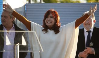 "Cristina Fernandez de Kirchner greets supporters at a campaign rally in Santa Rosa, Argentina, Thursday, Oct. 17, 2019. Fernandez is the running mate of Alberto Fernandez, behind left, and together they are the leading opposition ticket for the ""Frente de Todos"" party ahead of the presidential election on Oct. 27. (AP Photo/Natacha Pisarenko)"