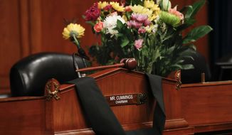 A gavel is left ontop of the House Oversight Committee Chairman's seat that is draped in black cloth honoring Rep. Elijah Cummings, D-Md., on Capitol Hill in Washington, Thursday, Oct. 17, 2019. Cummings past away earlier this morning. (AP Photo/Pablo Martinez Monsivais)