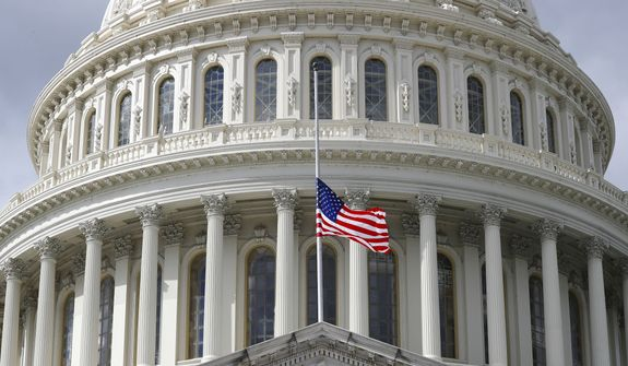 The flag above the US Capitol in Washington flies at half-staff honoring Rep. Elijah Cummings, D-Md., who passed away, Thursday, Oct. 17, 2019. (AP Photo/Pablo Martinez Monsivais)