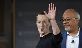 Facebook CEO Mark Zuckerberg speaks at Georgetown University, Thursday, Oct. 17, 2019, in Washington. At right is Mo Elleithee, the founding Executive Director of Georgetown University's Institute of Politics and Public Service. (AP Photo/Nick Wass)