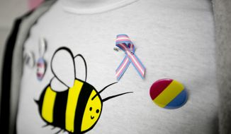 A ribbon depicting the transgender flag is displayed on a mannequin during a community game night on Thursday, Oct. 10, 2019, at Genderbands' office in Orem, Utah. (Isaac Hale/The Daily Herald via AP) ** FILE **