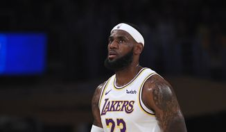Los Angeles Lakers forward LeBron James looks on during the first half of a preseason NBA basketball game against the Golden State Warriors Wednesday, Oct. 16, 2019, in Los Angeles. (AP Photo/Mark J. Terrill)
