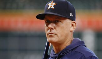 Houston Astros manager AJ Hinch watches during batting practice before Game 1 of baseball's American League Championship Series against the New York Yankees Saturday, Oct. 12, 2019, in Houston. (AP Photo/Matt Slocum)