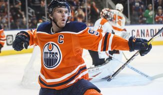Edmonton Oilers' Connor McDavid celebrates a goal against the Philadelphia Flyers during the second period of an NHL hockey game Wednesday, Oct. 16, 2019, in Edmonton, Alberta. (Jason Franson/The Canadian Press via AP)