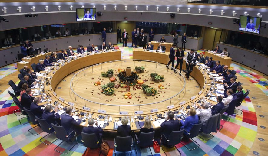 European Union leaders attend a round table meeting at an EU summit in Brussels, Thursday, Oct. 17, 2019. Britain and the European Union reached a new tentative Brexit deal on Thursday, hoping to finally escape the acrimony, divisions and frustration of their three-year divorce battle. (AP Photo/Olivier Matthys, Pool)