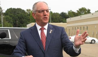 "Louisiana Gov. John Bel Edwards, a Democrat seeking a second term in office, criticizes his Republican opponent Eddie Rispone's proposal to ""freeze"" enrollment in the state's Medicaid expansion program, Thursday, Oct. 17, 2019, in Baton Rouge, La. (AP Photo/Melinda Deslatte)"