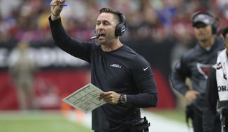 Arizona Cardinals head coach Kliff Kingsbury makes a call during the first half of an NFL football game against the Atlanta Falcons, Sunday, Oct. 13, 2019, in Glendale, Ariz. (AP Photo/Ross D. Franklin)