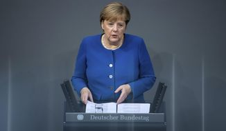 German Chancellor Angela Merkel speaks at the German parliament Bundestag in Berlin, Germany, Thursday, Oct.17, 2019. (Bernd von Jutrczenka/dpa via AP)