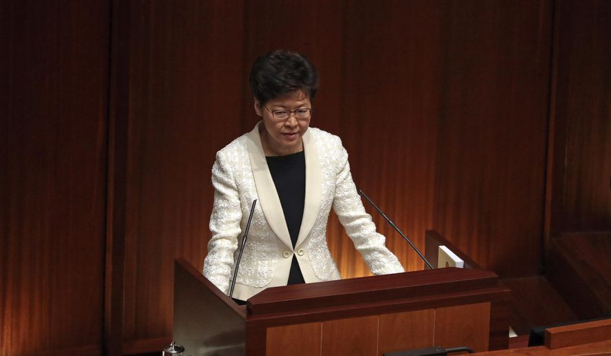 Hong Kong Chief Executive Carrie Lam speaks as she attends a question and answer session with lawmakers at the chamber of the Legislative Council in Hong Kong, Thursday, Oct. 17, 2019. (AP Photo/Mark Schiefelbein)