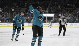 San Jose Sharks' Evander Kane, center, celebrates his goal against the Carolina Hurricanes during the first period of an NHL hockey game Wednesday, Oct. 16, 2019, in San Jose, Calif. (AP Photo/Ben Margot)