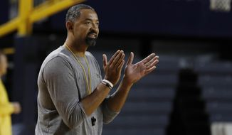 Michigan head basketball coach Juwan Howard attends an open practice, Thursday, Oct. 17, 2019 in Ann Arbor, Mich. Michigan held its men's basketball media day Thursday, another first for Howard as he prepares for his initial season at the helm. The former Fab Five star returned to his school after coach John Beilein left for the NBA this offseason. (AP Photo/Carlos Osorio)