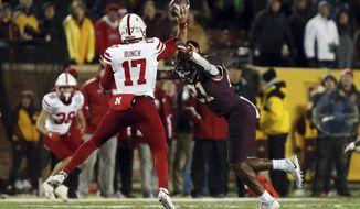 Minnesota linebacker Kamal Martin (21) sacks Nebraska quarterback Andrew Bunch (17) during the second half of an NCAA college football game Saturday, Oct. 12, 2019, in Minneapolis. (AP Photo/Stacy Bengs)
