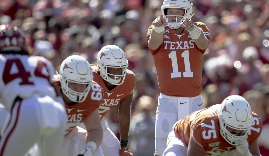 Texas quarterback Sam Ehlinger (11) directs his team against Oklahoma during the first half of an NCAA college football game at the Cotton Bowl, Saturday, Oct. 12, 2019, in Dallas. (Nick Wagner/Austin American-Statesman via AP) ** FILE **