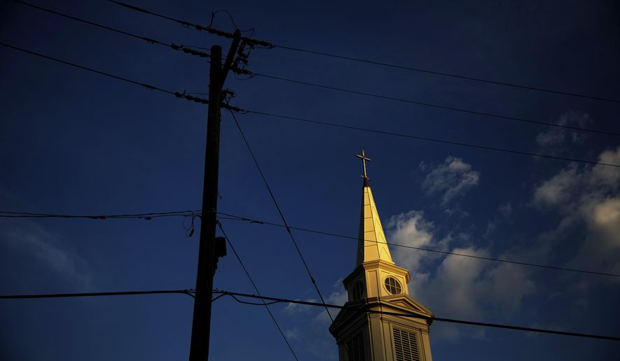 FILE - In this Tuesday, April 11, 2017 file photo, the sun sets on a Baptist church in Georgia. According to new data released Thursday, Oct. 17, 2019, by the Pew Research Center, the portion of Americans with no religious affiliation is rising significantly, in tandem with a sharp drop in the percentage that identifies as Christian. (AP Photo/David Goldman)