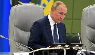 Russian President Vladimir Putin attends a meeting at the Russian Defense Ministry in Moscow, Russia, Thursday, Oct. 17, 2019. (Alexei Druzhinin, Sputnik, Kremlin Pool Photo via AP)