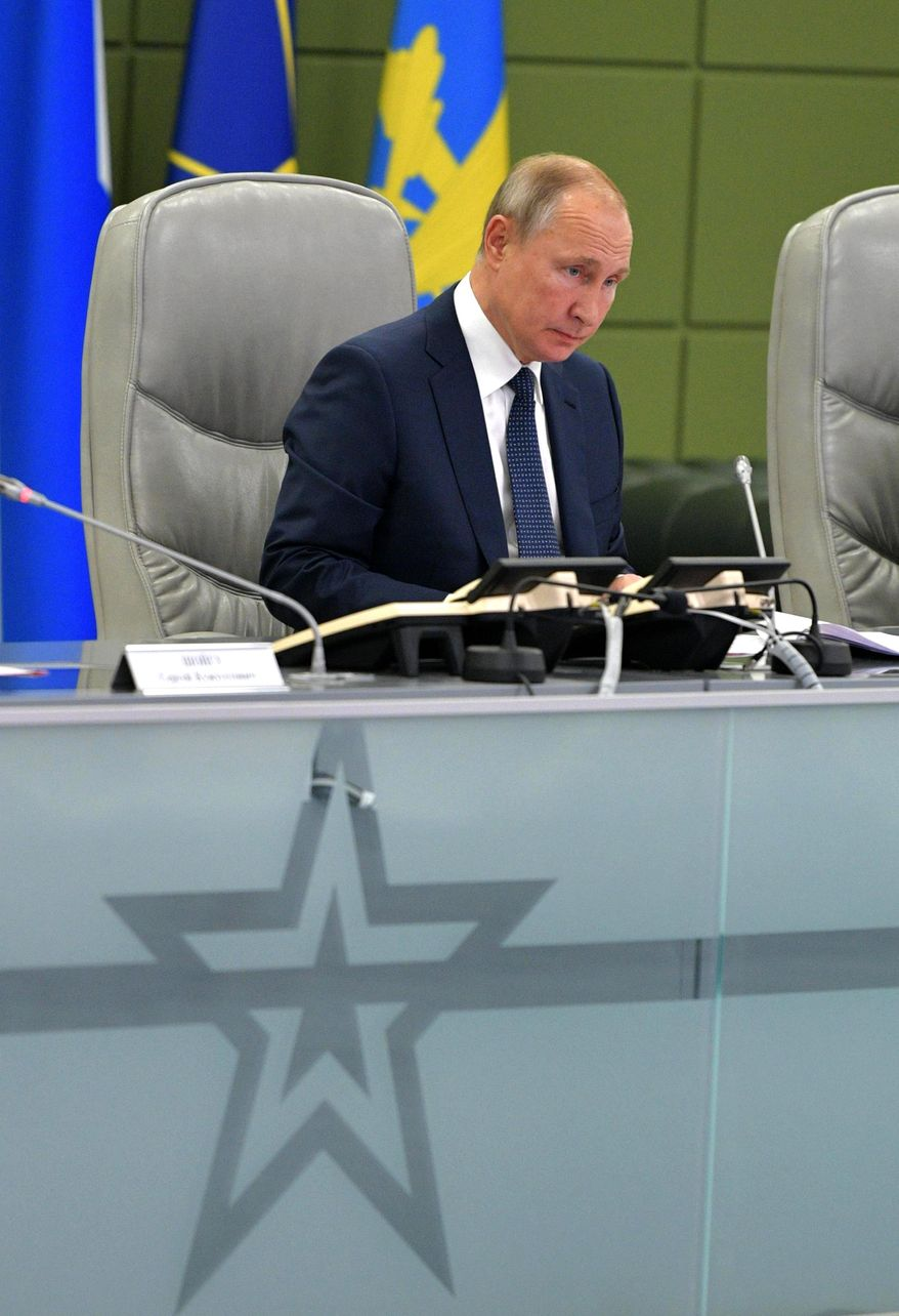 Russian President Vladimir Putin attends a meeting at the Russian Defense Ministry in Moscow, Russia, Thursday, Oct. 17, 2019. (Alexei Druzhinin, Sputnik, Kremlin Pool Photo via AP)