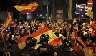 Right wing pro-Spanish unity supporters challenge police officers during a demonstration in Barcelona, Spain, Thursday, Oct. 17, 2019. Catalonia's separatist leader vowed Thursday to hold a new vote to secede from Spain in less than two years as the embattled northeastern region grapples with a wave of violence that has tarnished a movement proud of its peaceful activism. (AP Photo/Emilio Morenatti)