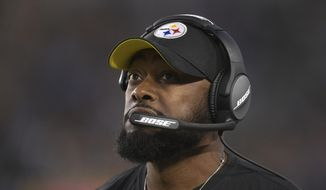 Pittsburgh Steelers head coach Mike Tomlin watches from the sidelines during the first half of an NFL football game against the Los Angeles Chargers, Sunday, Oct. 13, 2019, in Carson, Calif. (AP Photo/Kyusung Gong)
