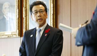 "Sapporo Mayor Katsuhiro Akimoto speaks to journalists about a new plan on the 2020 Olympic marathons and race walking events, at the city office in Sapporo, northern Japan Thursday, Oct. 17, 2019. The International Olympic Committee detailed a new plan Wednesday to stage the marathons and race walking events in Sapporo, the host city of the 1972 Winter Olympics, which ""will mean significantly lower temperatures for the athletes."" (Yohei Fukai/Kyodo News via AP)"