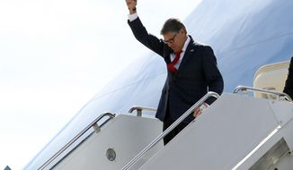 Energy Secretary Rick Perry gestures as he arrives on Air Force One with President Donald Trump at Naval Air Station Joint Reserve Base in Fort Worth, Texas, Thursday, Oct. 17, 2019. (AP Photo/Andrew Harnik)
