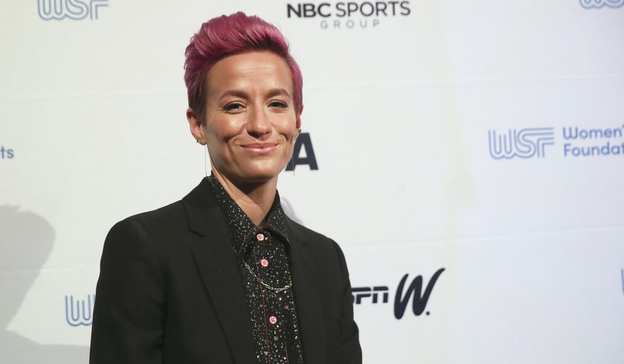 In this Wednesday, Oct. 16, 2019, photo soccer star Megan Rapinoe poses for photos on the red carpet of the Women's Sports Foundation's 40th annual Salute to Women in Sports in New York. Rapinoe, who was honored at the gala, won Sportswoman of the Year in the team category. She led the U.S. women's soccer team to victory at the World Cup in France and earned the FIFA Player of the Year award.  (AP Photo/Mary Altaffer)