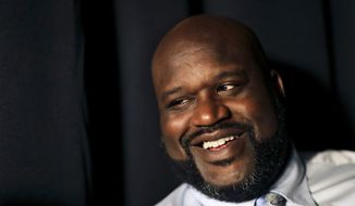 In this April 18, 2017, file photo, former NBA basketball player Shaquille O'Neal sits off-set on a break from taping a commercial in Atlanta. (AP Photo/David Goldman, File)