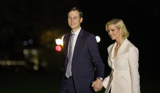 White House Senior Adviser Jared Kushner and his wife Ivanka Trump, the daughter and senior adviser to President Donald Trump, walk to the White House after stepping off Marine One on the South Lawn of the White House, early Friday, Oct. 18, 2019, in Washington. (AP Photo/Alex Brandon)