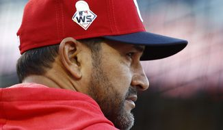 Washington Nationals manager Dave Martinez participates in a baseball workout, Friday, Oct. 18, 2019, in Washington, in advance of the team's appearance in the World Series. (AP Photo/Patrick Semansky)