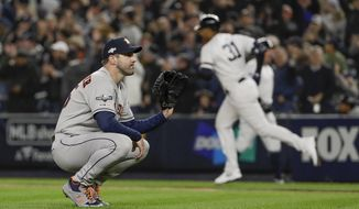 Houston Astros starting pitcher Justin Verlander (35) reacts after giving up a three-run home run against the New York Yankees during the first inning of Game 5 of baseball's American League Championship Series, Friday, Oct. 18, 2019, in New York. (AP Photo/Frank Franklin II)