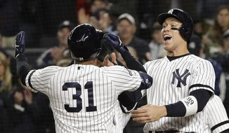 New York Yankees center fielder Aaron Hicks (31) celebrates with Aaron Judge after hitting a three-run home run against the Houston Astros during the first inning of Game 5 of baseball's American League Championship Series, Friday, Oct. 18, 2019, in New York. (AP Photo/Frank Franklin II)