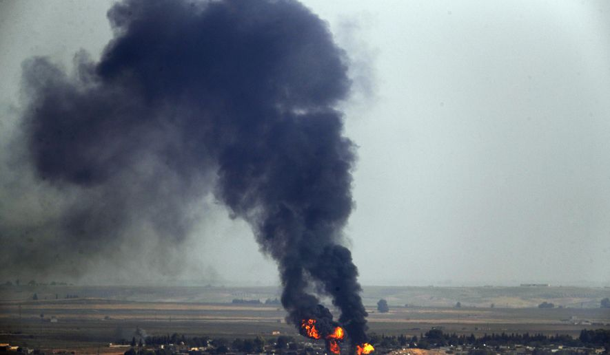 In this photo taken from the Turkish side of the border between Turkey and Syria, in Ceylanpinar, Sanliurfa province, southeastern Turkey, flames and smoke billow from a fire on a target in Ras al-Ayn, Syria, caused by shelling by Turkish forces, Thursday, Oct. 17, 2019. U.S. Vice President Mike Pence and State Secretary Mike Pompeo were scheduled to arrive in Ankara Thursday and press Turkey's President Recep Tayyip Erdogan to accept a ceasefire in northeast Syria. (AP Photo/Cavit Ozgul)