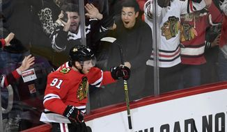 Chicago Blackhawks' Drake Caggiula (91) celebrates after scoring a goal during the first period of an NHL hockey game against the Columbus Blue Jackets, Friday, Oct 18, 2019, in Chicago. (AP Photo/Paul Beaty)