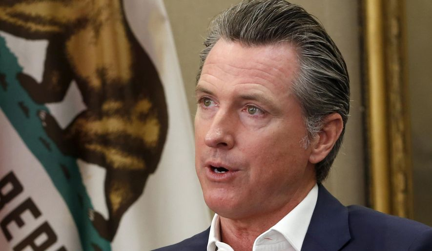 This Oct. 8, 2019, file photo, shows California Gov. Gavin Newsom during an interview in his office at the Capitol in Sacramento, Calif. California's governor is pardoning three more immigrants facing the possibility they will be deported. They are among four pardons and two commutations of youthful offenders announced Friday, Oct. 18, 2019, by Newsom. (AP Photo/Rich Pedroncelli, File)